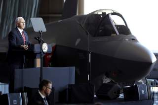 U.S. Vice President Mike Pence addresses members of U.S. military services and Japan Self-Defense Forces (JSDF) in front of a U.S. Air Force F-35 fighter before he departs for South Korea, at U.S. Air Force Yokota base in Fussa, on the outskirts of Tokyo,