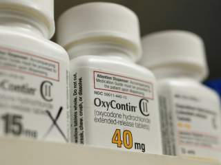 Bottles of prescription painkiller OxyContin made by Purdue Pharma LP sit on a shelf at a local pharmacy in Provo, Utah, U.S., April 25, 2017. REUTERS/George Frey