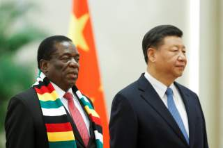 Chinese President Xi Jinping and President of Zimbabwe Emmerson Mnangagwa attend a welcoming ceremony before talks at the Great Hall of the People in Beijing, China April 3, 2018. REUTERS/Thomas Peter