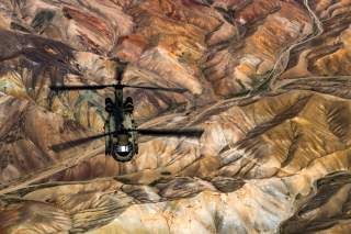 A U.S. Army Task Force Brawler CH-47F Chinook conducts a training exercise at Bagram Airfield, Afghanistan, March 26, 2018. Picture taken March 26, 2018. U.S. Air Force/Tech. Sgt. Gregory Brook/Handout via REUTERS.