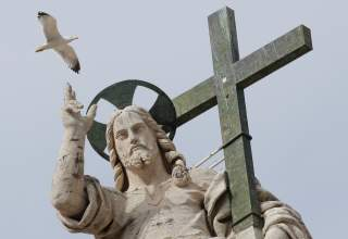 A seagull flies next to the statue of Jesus Christ during Pope Francis' Wednesday general audience in Saint Peter's square at the Vatican, April 18, 2018. REUTERS/Max Rossi