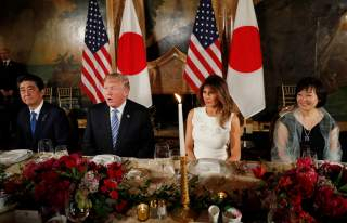 U.S. President Donald Trump (2nd from L) speaks as he sits down to dine with first lady Melania Trump, Japan's Prime Minister Shinzo Abe and his wife Akie (R) at Trump's Mar-a-Lago estate in Palm Beach, Florida, U.S., April 18, 2018. REUTERS/Kevin Lamarqu