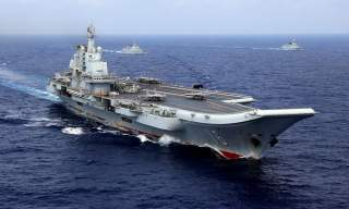 China's aircraft carrier Liaoning takes part in a military drill of Chinese People's Liberation Army (PLA) Navy in the western Pacific Ocean, April 18, 2018. Picture taken April 18, 2018. REUTERS/Stringer ATTENTION EDITORS - THIS IMAGE WAS PROVIDED BY A T