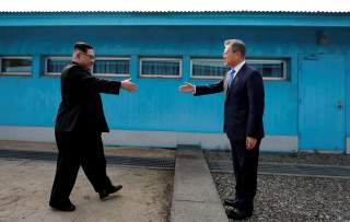 South Korean President Moon Jae-in and North Korean leader Kim Jong Un shake hands at the truce village of Panmunjom inside the demilitarized zone separating the two Koreas, South Korea, April 27, 2018. Korea Summit Press Pool/Pool via Reuters TPX IMAGES