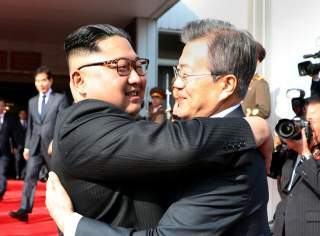 South Korean President Moon Jae-in bids fairwell to North Korean leader Kim Jong Un as he leaves after their summit at the truce village of Panmunjom, North Korea, in this handout picture provided by the Presidential Blue House on May 26, 2018. The Presid