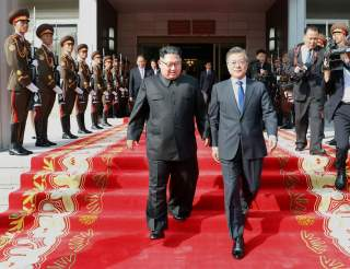 South Korean President Moon Jae-in and North Korean leader Kim Jong Un leave after their summit at the truce village of Panmunjom, North Korea, in this handout picture provided by the Presidential Blue House on May 26, 2018. Picture taken on May 26, 2018.