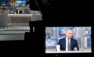 Russian President Vladimir Putin is seen on a video camera screen as he attends a live nationwide broadcast call-in in Moscow, Russia June 7, 2018. Sputnik/Mikhail Klimentyev/Kremlin via REUTERS