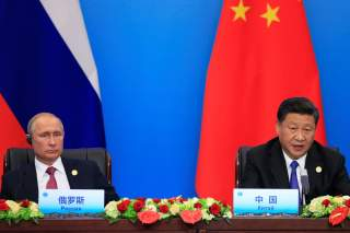 China's President Xi Jinping and Russia's President Vladimir Putin attend a signing ceremony during Shanghai Cooperation Organization (SCO) summit in Qingdao, Shandong Province, China June 10, 2018. REUTERS/Aly Song