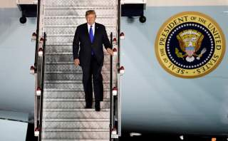 U.S. President Donald Trump steps off his plane as he arrives at Paya Lebar Air Base in Singapore, ahead of a summit with North Korean leader Kim Jong Un, June 10, 2018. REUTERS/Kim Kyung-Hoon