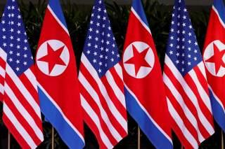 U.S. and North Korean national flags are seen during the meeting of U.S. President Donald Trump and North Korean leader Kim Jong Un at the Capella Hotel on Sentosa island in Singapore June 12, 2018. REUTERS/Jonathan Ernst