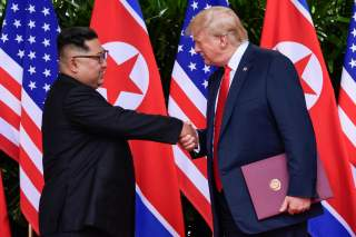 U.S. President Donald Trump and North Korea's leader Kim Jong Un shake hands during the signing of a document after their summit at the Capella Hotel on Sentosa island in Singapore June 12, 2018. Susan Walsh/Pool via Reuters