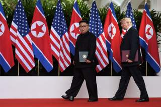 U.S. President Donald Trump and North Korea's leader Kim Jong Un walk during their summit at the Capella Hotel on Sentosa island in Singapore June 12, 2018. Anthony Wallace/Pool via Reuters TPX IMAGES OF THE DAY