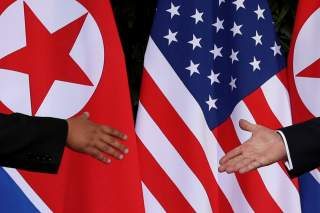 U.S. President Donald Trump and North Korea's leader Kim Jong Un meet at the start of their summit at the Capella Hotel on the resort island of Sentosa, Singapore June 12, 2018. Picture taken June 12, 2018. REUTERS/Jonathan Ernst