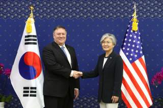 U.S. Secretary of State Mike Pompeo shakes hands with South Korean Foreign Minister Kang Kyung-wha during their meeting at the Foreign Ministry in Seoul, South Korea June 14, 2018. Chung Sung-Jun/Pool via REUTERS *** Local Caption *** Mike Pompeo; Kang Ky