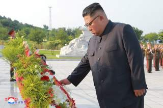 North Korean leader Kim Jong Un visits the Fatherland Liberation War Martyrs Cemetery in this undated photo released by North Korea's Korean Central News Agency (KCNA) on July 27, 2018. KCNA via REUTERS ATTENTION EDITORS - THIS IMAGE WAS PROVIDED BY A THI