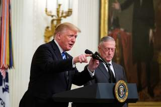 U.S. President Donald Trump delivers remarks alongside Defense Secretary James Mattis at a reception commemorating the 35th anniversary of the attack on the Beirut Barracks in the East Room of the White House, in Washington, U.S., October 25, 2018. REUTER