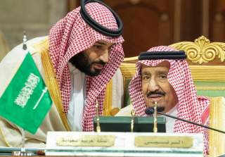 FILE PHOTO: Saudi Arabia's Crown Prince Mohammed bin Salman talks with Saudi Arabia's King Salman bin Abdulaziz Al Saud during the Gulf Cooperation Council's (GCC) Summit in Riyadh, Saudi Arabia Dec. 9, 2018. Bandar Algaloud/Courtesy of Saudi Royal Court/