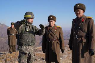 Soldiers from North and South Korea verify the removal of guard posts on each side of the Demilitarized Zone, December 12, 2018. South Korean Defence Ministry/Handout via REUTERS THIS IMAGE HAS BEEN SUPPLIED BY A THIRD PARTY.