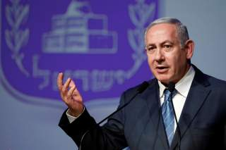 Israeli Prime Minister Benjamin Netanyahu speaks to members of the foreign media during annual New Year's toast event in Jerusalem December 12, 2018. REUTERS/Amir Cohen