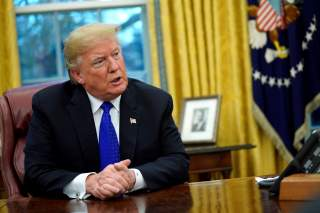 FILE PHOTO: U.S. President Donald Trump sits for an exclusive interview with Reuters journalists in the Oval Office at the White House in Washington, U.S. December 11, 2018. REUTERS/Jonathan Ernst/File Photo