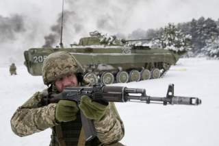An Ukrainian Army reservist takes part in military exercises at the Ukrainian Army training centre