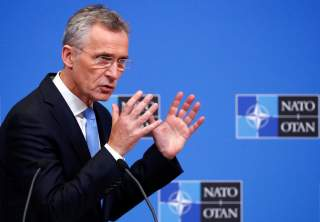 NATO Secretary General Jens Stoltenberg addresses a news conference during a NATO defence ministers meeting at the Alliance headquarters in Brussels, Belgium February 14, 2019. REUTERS/Francois Lenoir