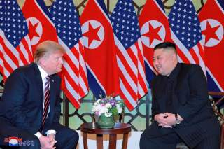 North Korea's leader Kim Jong Un and U.S. President Donald Trump speak during the second U.S.-North Korea summit in Hanoi, Vietnam, in this photo released on February 28, 2019 by North Korea's Korean Central News Agency (KCNA). KCNA via REUTERS ATTENTION