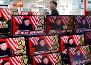 A clerk watches a set of TV's broadcasting a news report on a Hanoi summit between North Korean leader Kim Jong Un and U.S. President Donald Trump, in Seoul, South Korea, February 28, 2019. REUTERS/Kim Hong-Ji