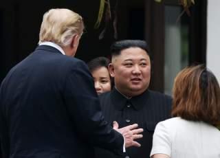North Korea's leader Kim Jong Un and U.S. President Donald Trump talk at the Metropole hotel during the second North Korea-U.S. summit in Hanoi, Vietnam February 28, 2019. REUTERS/Leah Millis