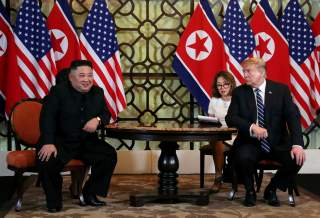 U.S. President Donald Trump looks towards North Korean leader Kim Jong Un during the one-on-one bilateral meeting at the second North Korea-U.S. summit in Hanoi, Vietnam February 28, 2019. REUTERS/Leah Millis TPX IMAGES OF THE DAY
