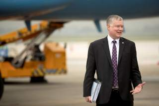 U.S. Special Representative for North Korea Stephen Biegun, stands on the tarmac as U.S. Secretary of State Mike Pompeo (not pictured) boards his plane at Nom Bar International Airport in Hanoi, February 28, 2019. Andrew Harnik/Pool via REUTERS