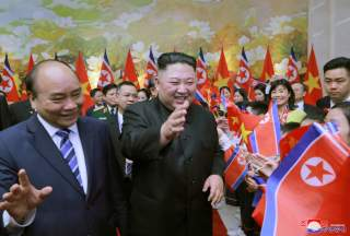 North Korean leader Kim Jong Un and Vietnam's Prime Minister Nguyen Xuan Phuc are welcomed by people in Hanoi, Vietnam March 1, 2019 in this photo released by North Korea's Korean Central News Agency (KCNA) on March 2, 2019. KCNA via REUTERS ATTENTION EDI