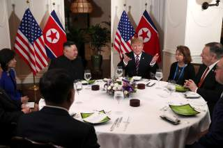 FILE PHOTO - U.S. President Donald Trump and North Korean leader Kim Jong Un sit down for a dinner during the second U.S.-North Korea summit at the Metropole Hotel in Hanoi, Vietnam February 27, 2019. Also pictured at right are U.S. Secretary of State Mik