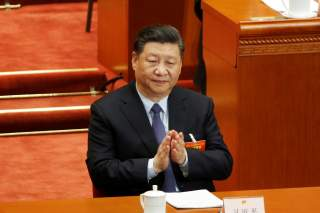 Chinese President Xi Jinping claps his hands at the second plenary session of the National People's Congress (NPC) at the Great Hall of the People in Beijing, China March 8, 2019. REUTERS/Thomas Peter