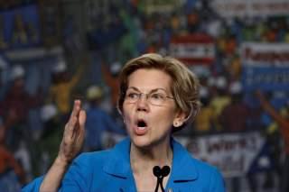 FILE PHOTO: Democratic U.S. presidential candidate Senator Elizabeth Warren (D-MA) speaks at the North America's Building Trades Unions (NABTU) 2019 legislative conference in Washington, U.S., April 10, 2019. To match Special Report USA-HOUSING/BILL REUTE