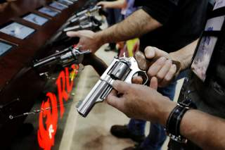 A man handles a Ruger revolver during the National Rifle Association (NRA) annual meeting in Indianapolis, Indiana, U.S., April 27, 2019. REUTERS/Lucas Jackson