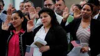 Immigrants take the Oath of Allegiance to become a U.S. citizens during an official Naturalization Ceremony at the Museum of Fine Arts, Boston in Boston, Massachusetts, U.S., May 6, 2019. REUTERS/Brian Snyder