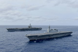 The Navy's forward-deployed aircraft carrier USS Ronald Reagan operates with the Japan Maritime Self-Defense Force helicopter carrier JS Izumo (R) in South China Sea June 11, 2019. Picture taken June 11, 2019. Courtesy JMSDF/U.S. Navy/Handout via REUTERS
