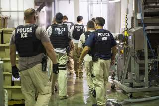 Homeland Security Investigations (HSI) officers from Immigration and Customs Enforcement (ICE) look on after executing search warrants and making some arrests at an agricultural processing facility in Canton, Mississippi, U.S. in this August 7, 2019 hando