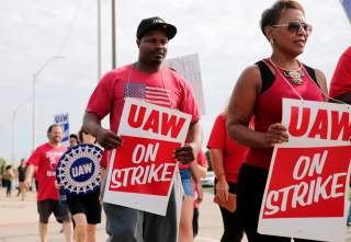 General Motors Detroit-Hamtramck Assembly plant worker Pierre Duhart walks the picket line during the United Auto Workers (UAW) national strike in Hamtramck, Michigan, U.S., September 22, 2019. REUTERS/Rebecca Cook