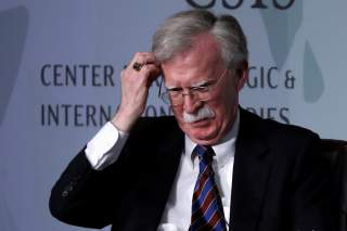 White House former National Security Advisor John Bolton fixes his hair and listens to a question after his remarks on North Korea at the Center for Strategic and International Studies (CSIS) think tank in Washington, U.S. September 30, 2019.