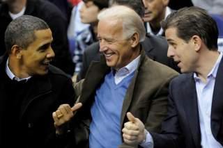U.S. President Barack Obama, Vice President Joe Biden and his son Hunter Biden attend an NCAA basketball game between Georgetown University and Duke University in Washington, U.S., January 30, 2010. Picture taken January 30, 2010. REUTERS/Jonathan Ernst