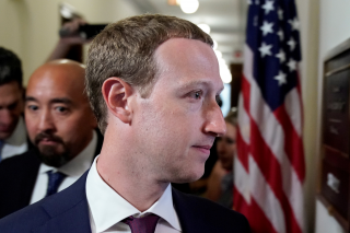 Facebook Chief Executive Mark Zuckerberg enters the office of U.S. Senator Josh Hawley (R-MO) while meeting with lawmakers to discuss