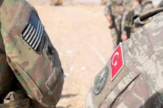 U.S. and Turkish military forces conduct a joint ground patrol inside the security mechanism area in northeast, Syria, October 4, 2019. Picture taken October 4, 2019. U.S. Army/Staff Sgt. Andrew Goedl/Handout via REUTERS.