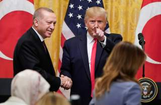 U.S. President Donald Trump greets Turkey's President Tayyip Erdogan after a joint news conference at the White House in Washington, U.S., November 13, 2019. REUTERS/Joshua Roberts