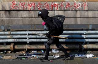 A protester walks at the occupied campus of the Chinese University in Hong Kong, China, November 13, 2019. REUTERS/Thomas Peter