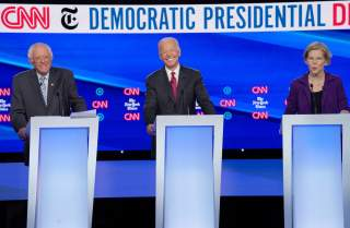 Democratic presidential candidates Senator Bernie Sanders and former Vice President Joe Biden listen to Senator Elizabeth Warren as they debate during the fourth U.S. Democratic presidential candidates 2020 election debate in Westerville, Ohio