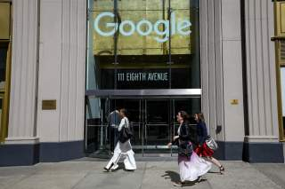 People pass by an entrance to Google offices in New York, U.S., June 4, 2019. REUTERS/Brendan McDermid/