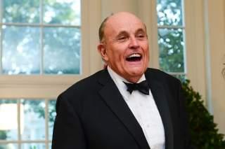 FILE PHOTO: Rudy Giuliani arrives for a State Dinner for Australia's Prime Minister Scott Morrison at the White House in Washington, U.S. September 20, 2019. REUTERS/Erin Scott/File Photo