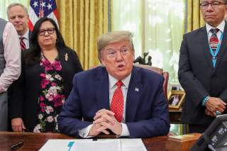 U.S. President Donald Trump speaks while signing an Executive Order